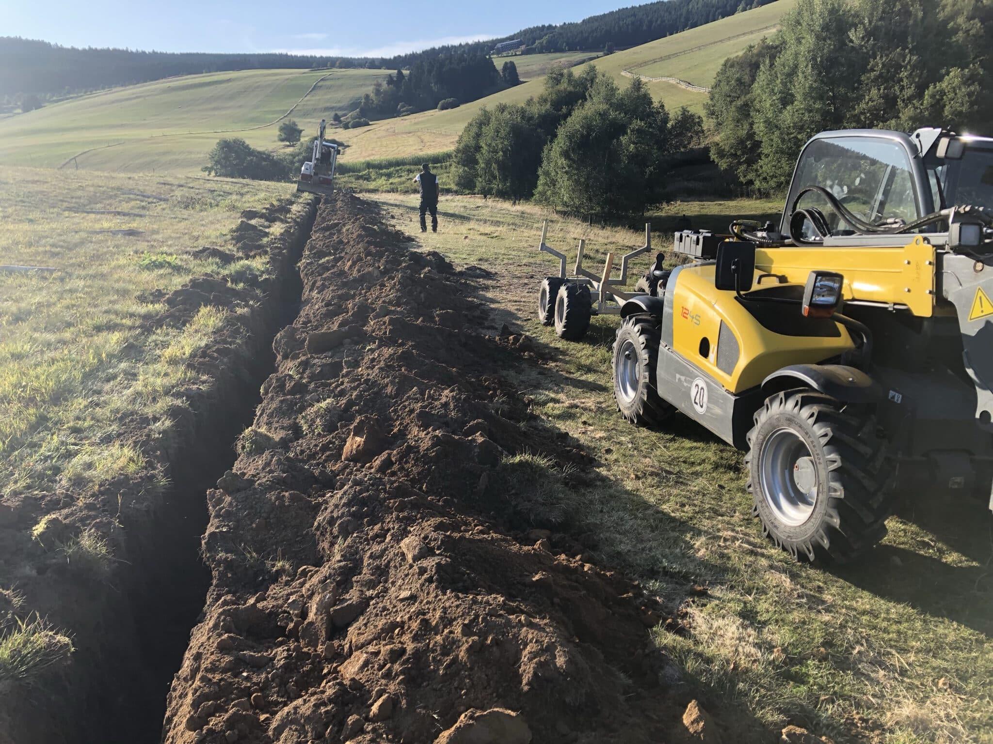Graben für den Untergrabschutz Alpaka